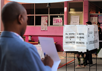 A CEP member takes notes during election observation in a polling station in Polanco, Mexico City.