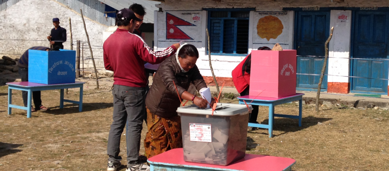A voter casts a ballot in Lamjung.