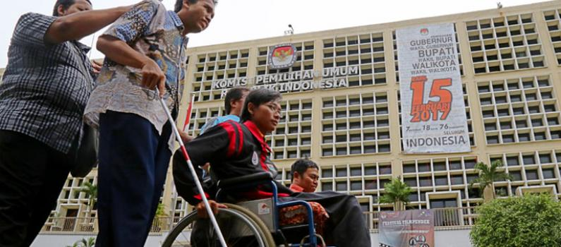The first runner up for most inclusive photo featured persons with different types of disabilities in front of the KPU. Source: AGENDA