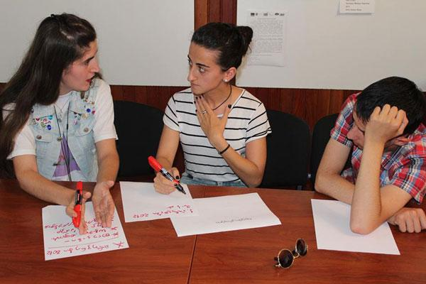 IFES Democracy and Citizenship course alumni conduct a planning session for a student action project.
